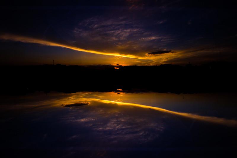 orange sunset reflected into a lake